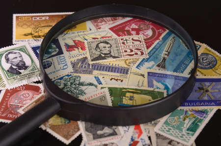 lens is located on a group of old postage stamps