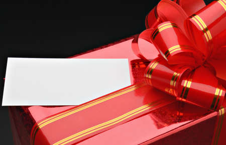 Gift packing by close up against a dark background