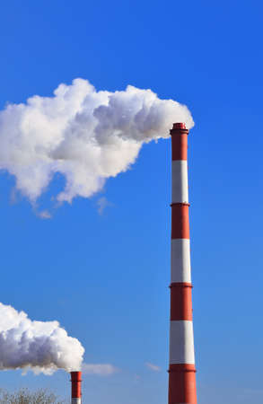 outdoor electricity: Industrial pipe with emission of a smoke (environmental problem)