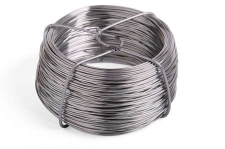 Roll of iron wire, close up on a white background Standard-Bild