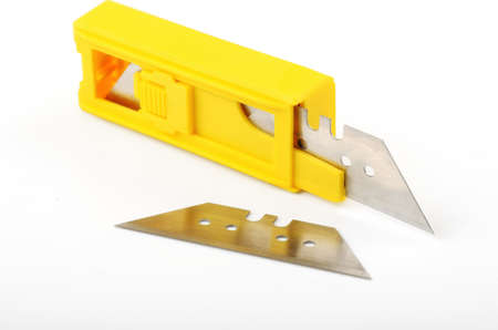 replaceable: replaceable unit stationery knife on a white background