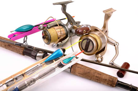 A set of fishing equipment on white background photo