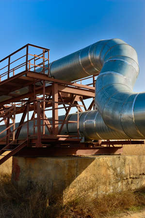 air duct: heat pipe to the metal structure on a background of blue sky
