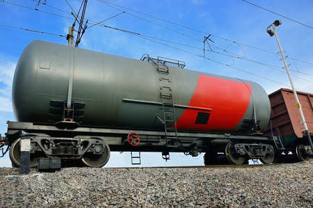 railway tank for transportation of petroleum products on a background of blue sky photo