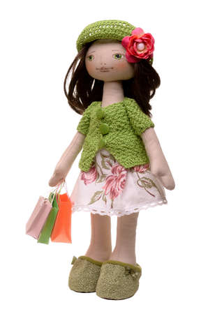 soft toy doll shopaholic isolated on white background photo