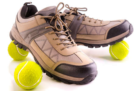 Sneakers and tennis balls  on white background photo