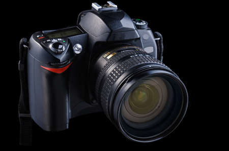 digital SLR camera on a black background photo