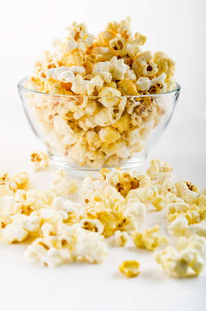bowl of popcorn: popcorn in a glass on a white background