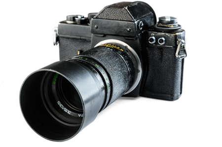 reflex: vecchia macchina fotografica reflex su uno sfondo bianco