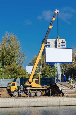 mounts: crane mounts the billboard Stock Photo