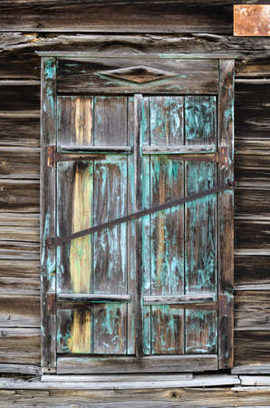 deadbolt: old wooden shutters closed on the metallic deadbolt