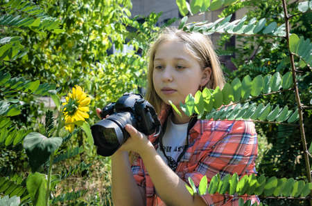 Portrait of a young teen girl with camera photo