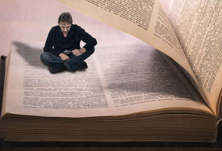 man reading a book, concept of immersion in the book. photo