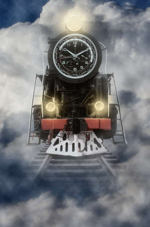transience: locomotive with dial edit on the road in the clouds. The concept of the transience of life.