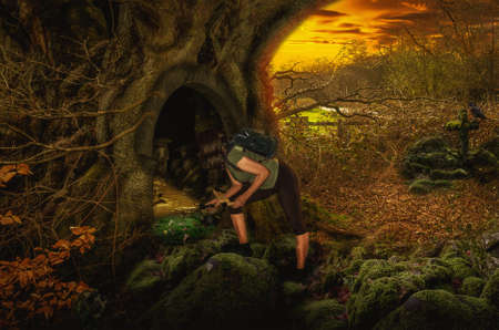 researcher: Girl in fairy forest found the secret entrance to the dungeon. Stock Photo