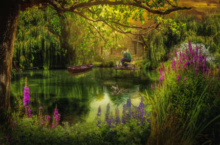 dock: old fisherman with a fishing rod napping in his hands on the shore of the fairy lake