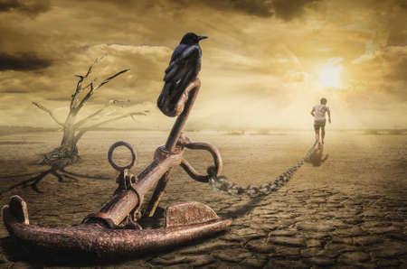 Człowiek związany z problemami z przeszłości nie daje się przenieść w przyszłość Zdjęcie Seryjne