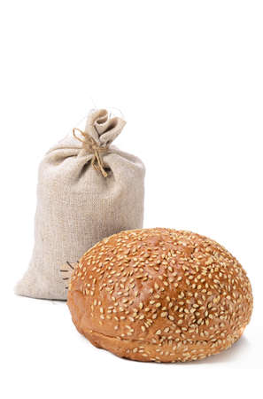 fresh bun, sprinkled with sesame seeds on a white background with soft shadow Standard-Bild