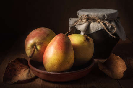 ripe pears on a dark wooden background