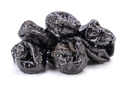 prunes on white background with soft shadow