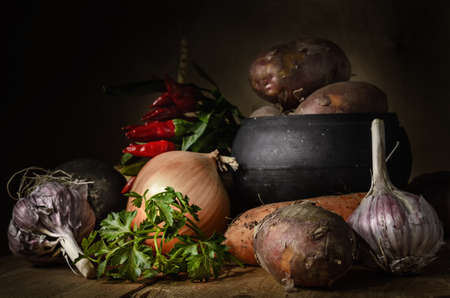 vegetables in a group on a wooden shelf in a dark rustic style