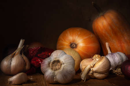 autumn still life in a rustic style on a dark wooden background.
