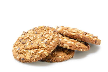 oatmeal cookies sprinkled with cereal grains on white background with soft shadow