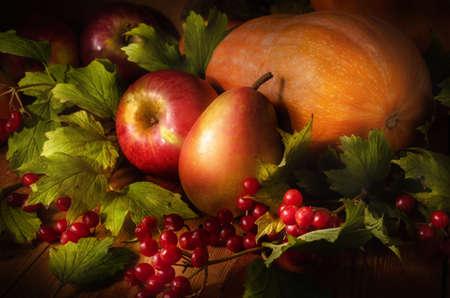 autumn still life in a rustic style on a dark wooden background. Standard-Bild