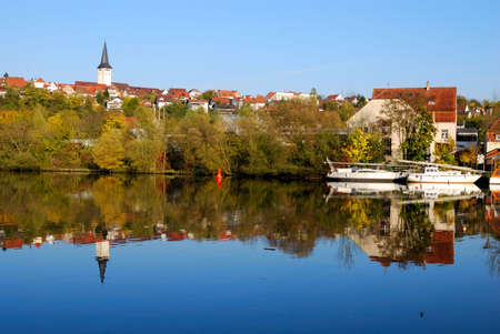 Freiberg pier and its reflection in Nekar river, south-western Germany photo