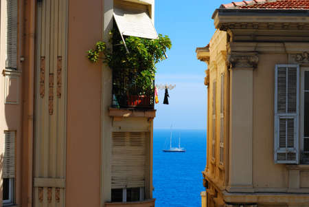 french riviera: Monte Carlo glamour holiday: blue sea and yacht between two hotels, Monaco
