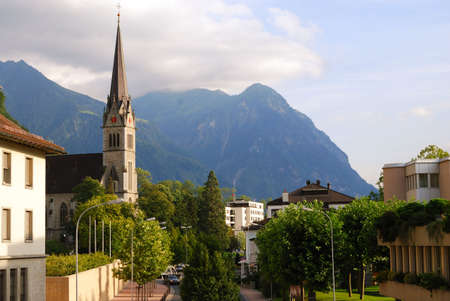 liechtenstein: Vaduz church, street and Alps, Liechtenstein, panoramic view Stock Photo