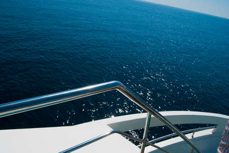 View from the yacht in the sunlit open sea photo