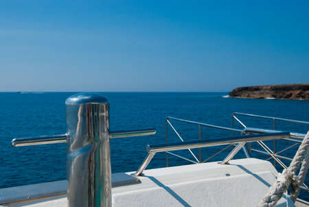 View from the yacht in the sea and the rocky shore photo