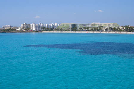 Tur quoise waters of Mediterranean Sea and Sa Coma hotels, Majorca island, Spain photo