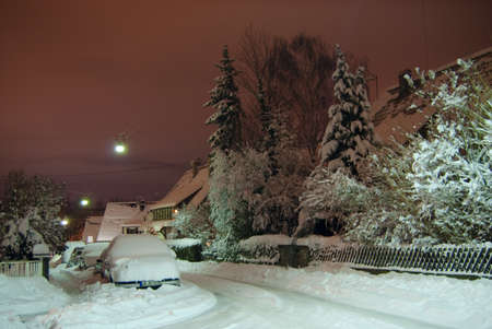 Night street of Stuttgart-Ludwigsburg and cars covered in snow, Germany, December 2010 photo