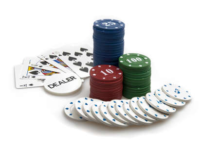 Winning hand - poker chips and royal flush of spades isolated against white background