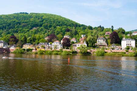 Boat on Neckar river and Heidelberg coast, Baden Wuerttemberg, Germany photo