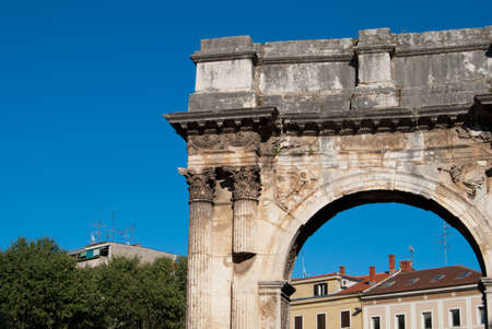 Ancient roman arch in Pula town center, Croatia photo