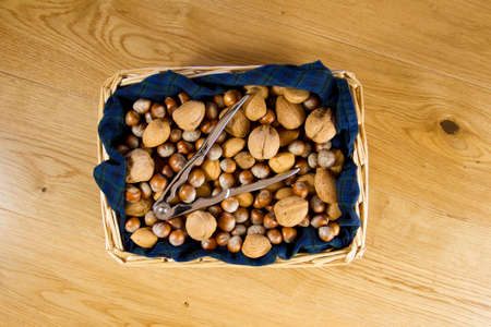 Wicker basket of nuts in tartan fabric Stock Photo