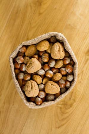 overhead shot: Overhead shot of hessian sack full of nuts