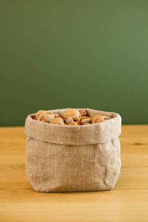 Hessian sack full of nuts photo
