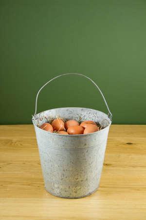 Metal bucket of eggs