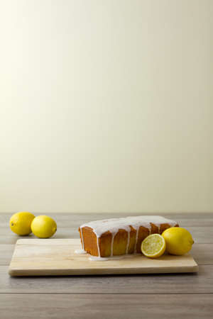 unsliced: Unsliced glazed lemon loaf cake Stock Photo