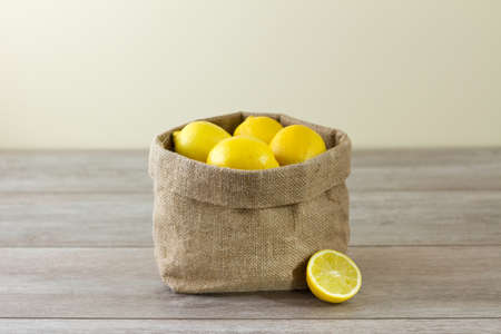 Jute sack of lemons, horizontal