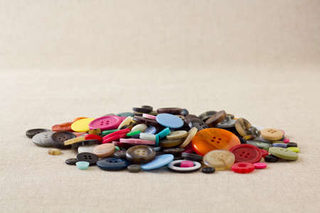 Many mixed, brightly coloured sewing or clothing buttons