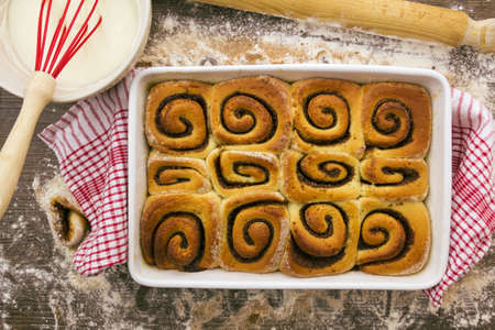 Part of a series showing the preparation of cinnamon rolls. Stock Photo