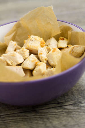 Cooked bitesize pieces of chicken breast in bowl