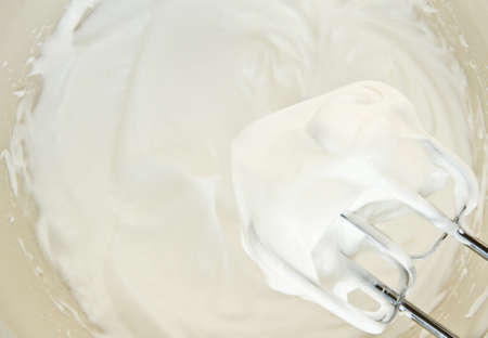 Egg whites that have been whipped to stiff peaks consistency. Stock Photo