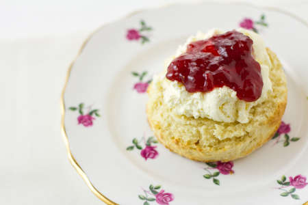 English scones, Devonshire style, on chine plate. Part of a series showing the preparation of scones.