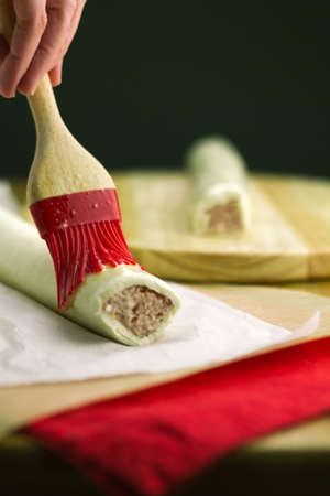 Part of a series showing the preparation of sausage rolls. Stock Photo
